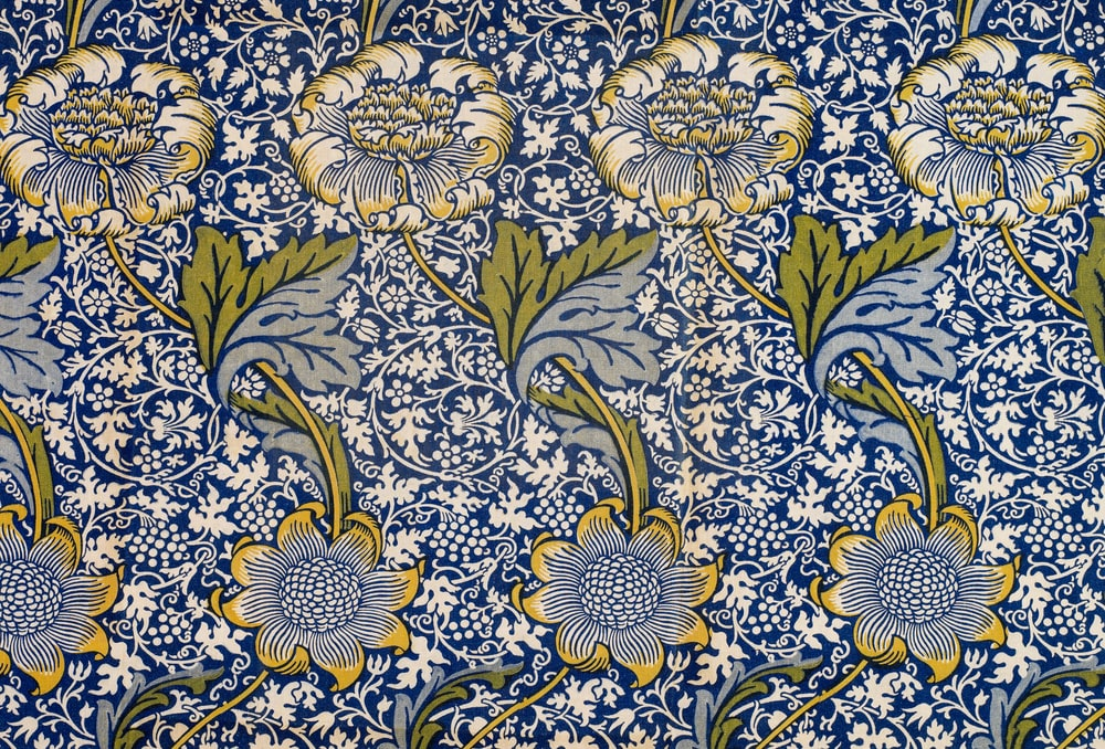 white blue and green floral textile