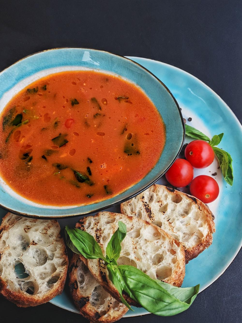 soup with sliced of vegetables on blue ceramic bowl