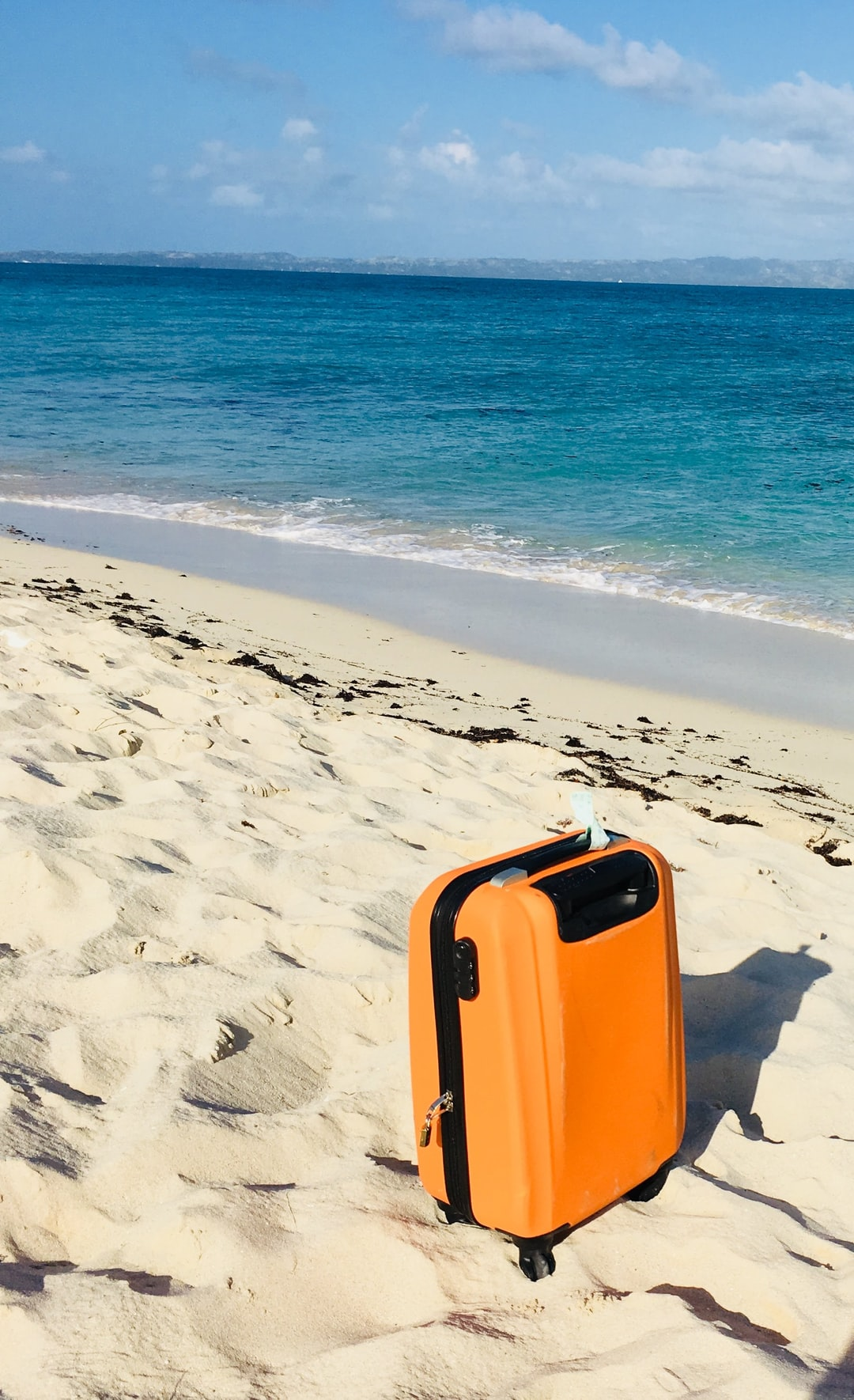 This was my lovely orange carry-on. I loved the color contrast on the beach on the island of Ile a Vache, Haiti.