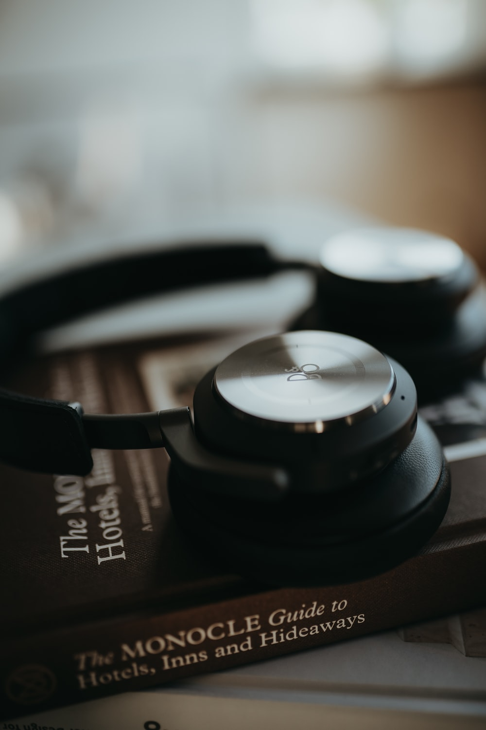 black and silver headphones on brown and black textile