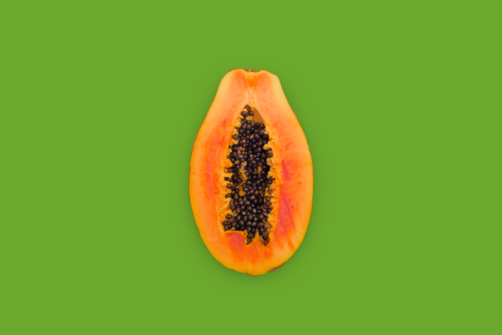 yellow and brown fruit with green background