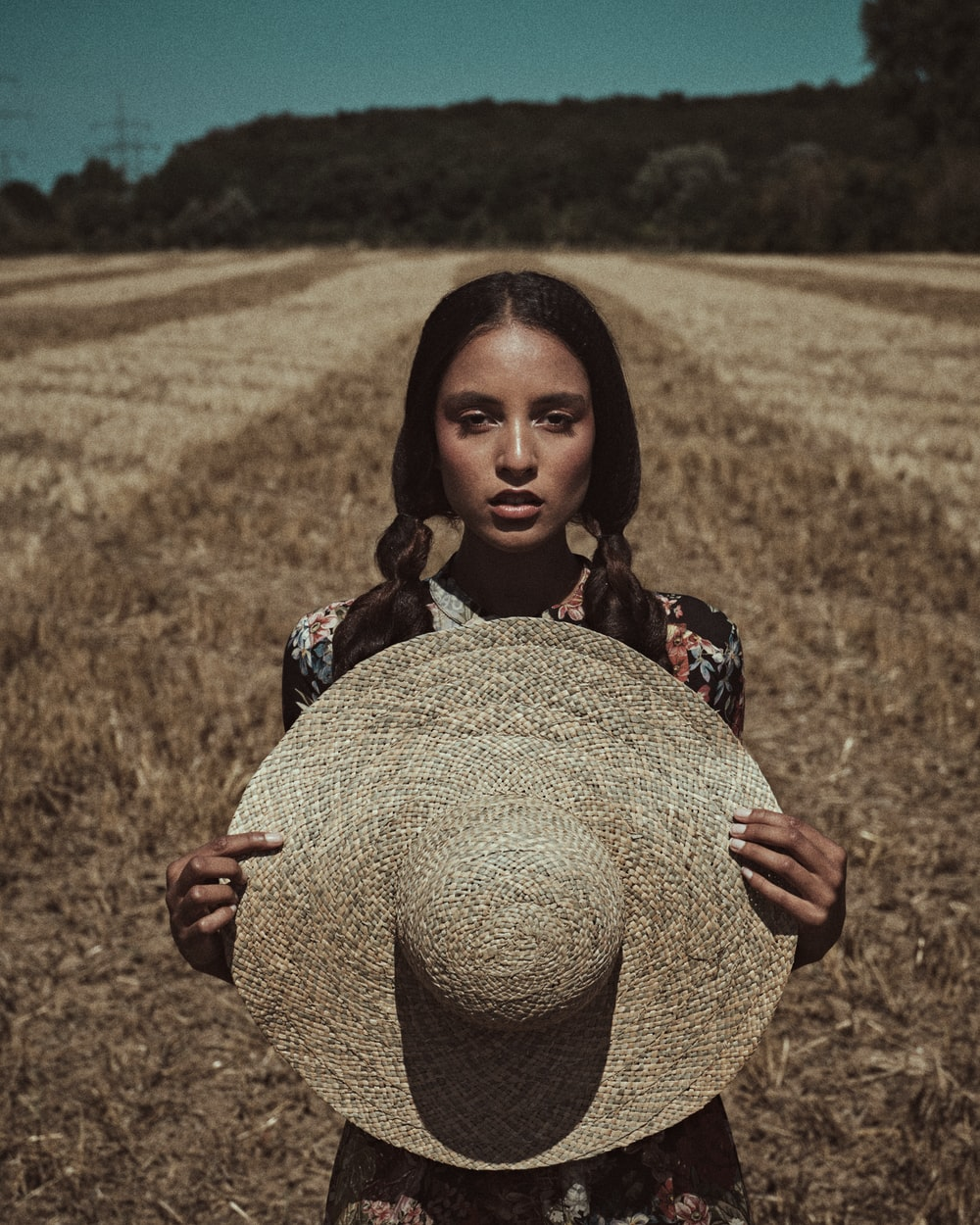 girl in brown hat on brown field during daytime