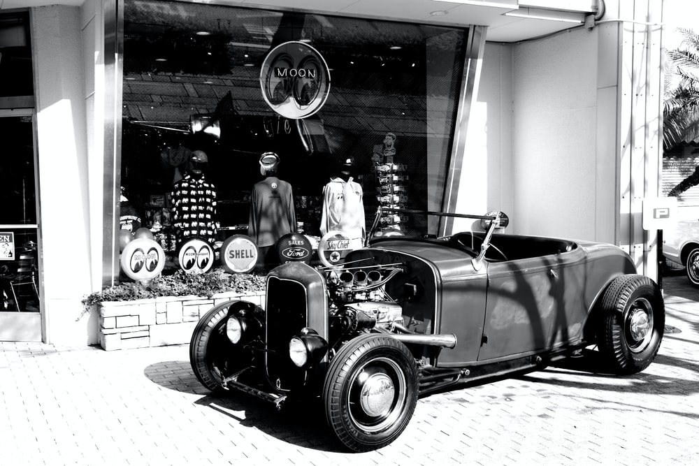 vintage black car in grayscale photography