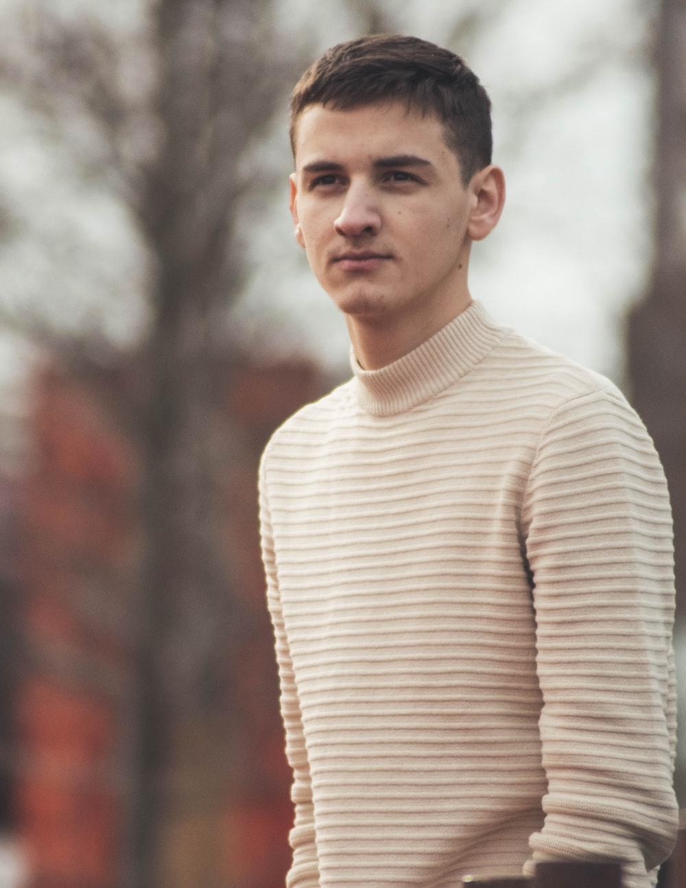 man in white turtleneck sweater