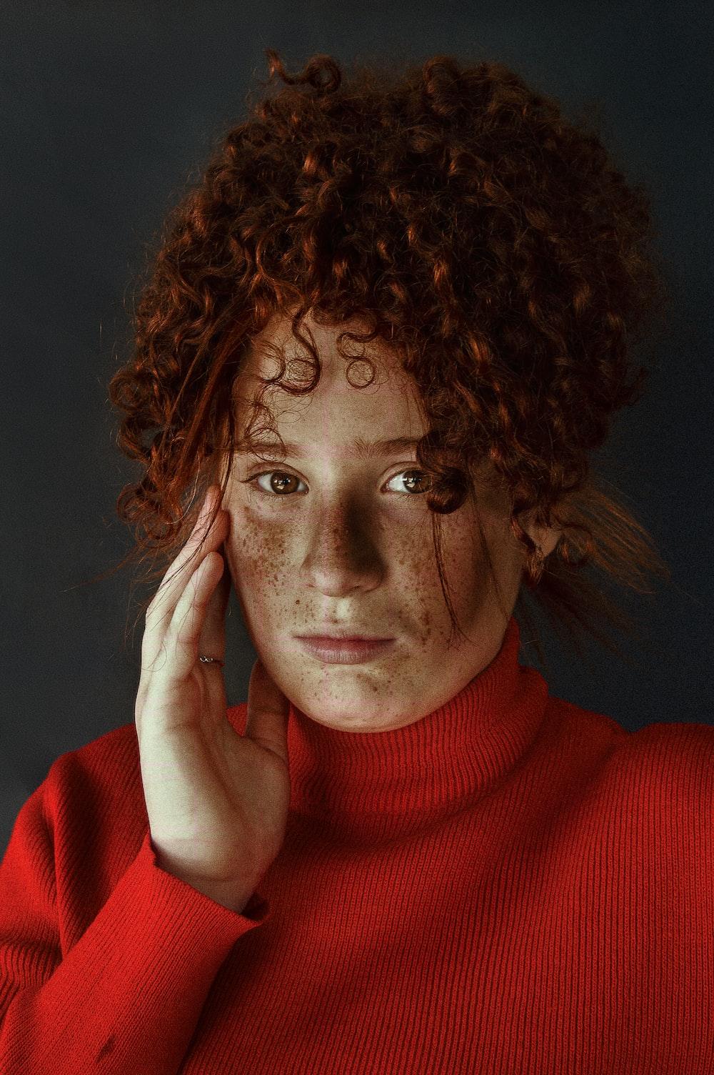 woman in red turtleneck sweater wearing silver framed eyeglasses