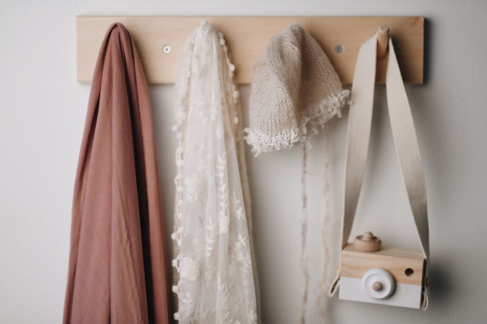 white lace textile beside brown wooden shelf