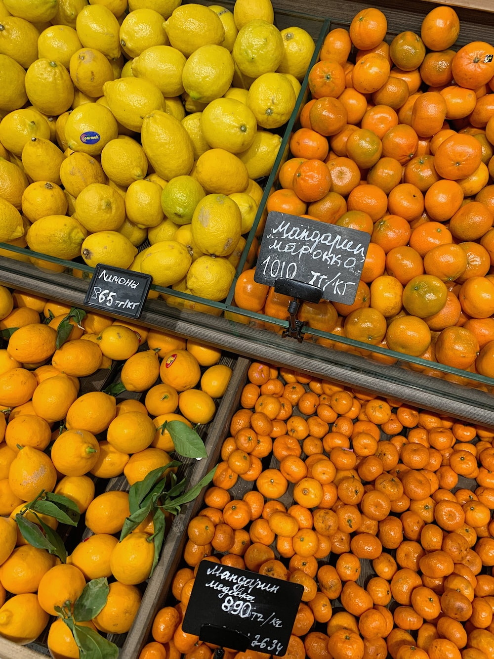yellow and orange fruits on brown wooden crate