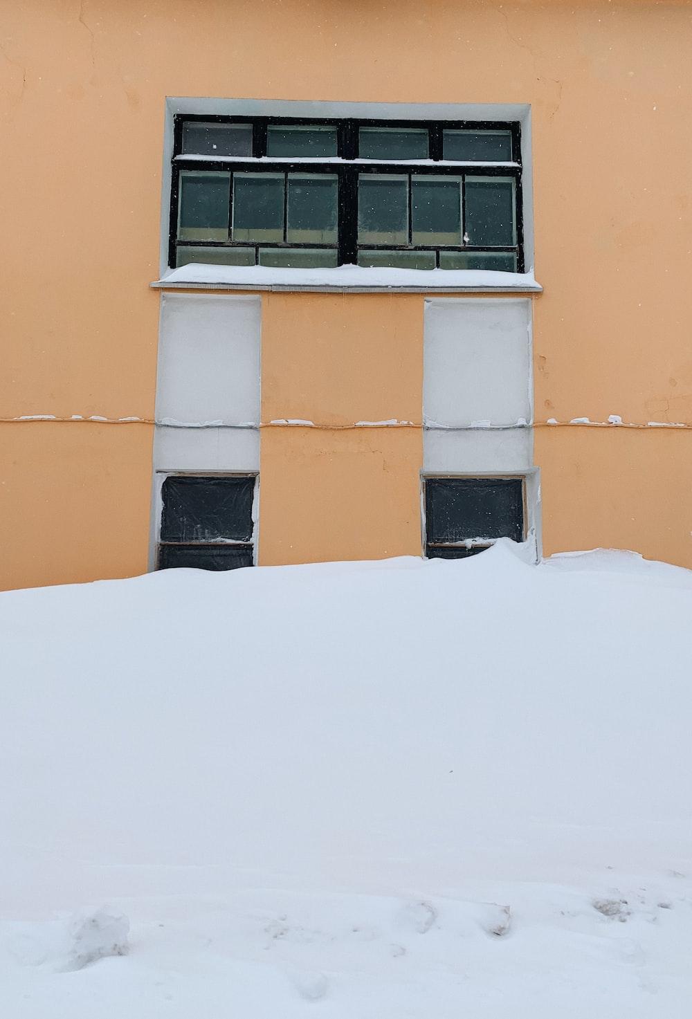 orange concrete building with black window frame