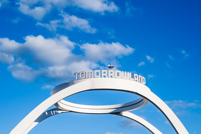 white and blue round frame under blue sky during daytime tomorrowland teams background