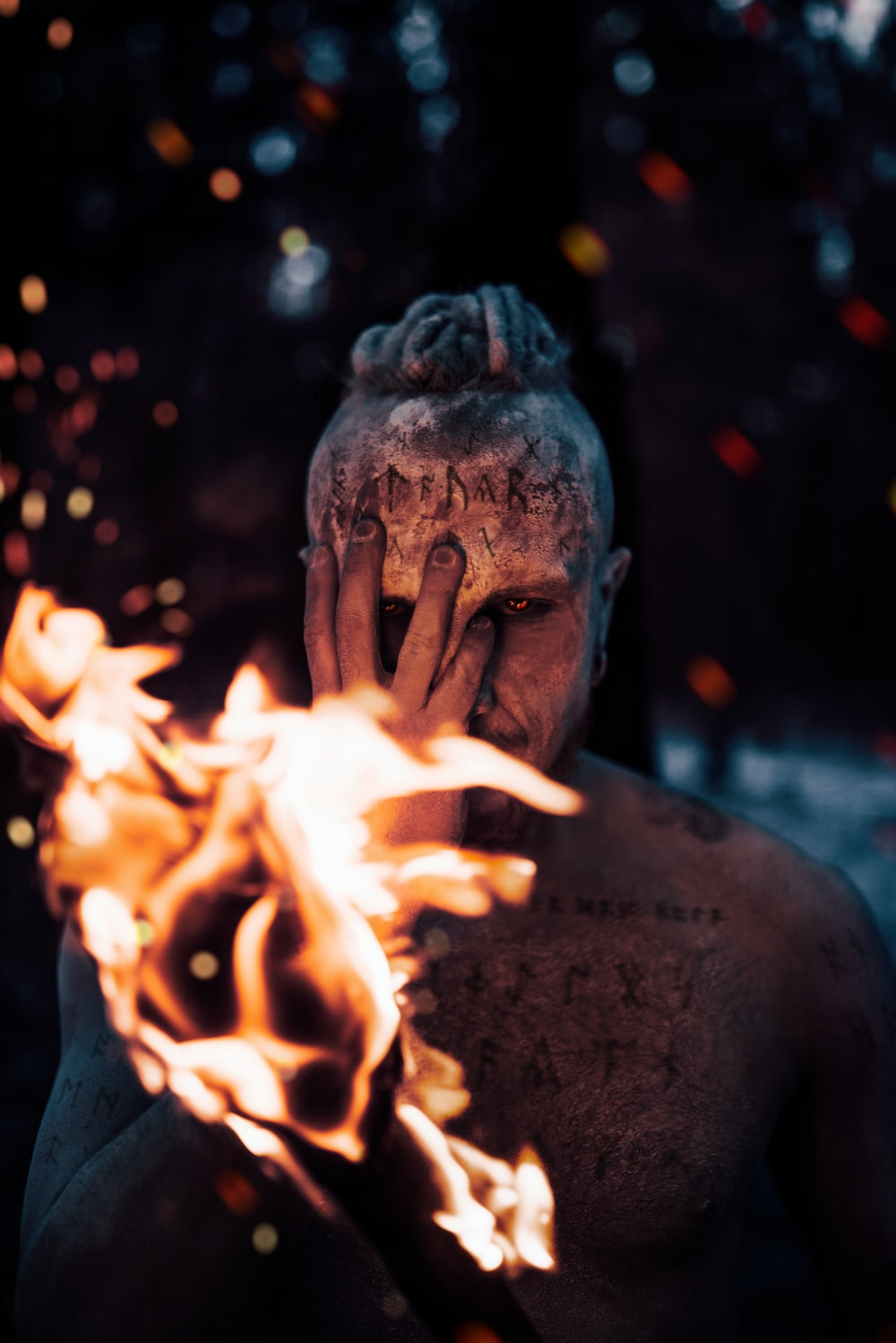 man with fire on his face
