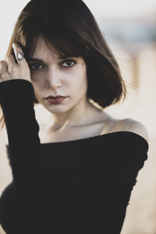 woman in black off shoulder long sleeve shirt