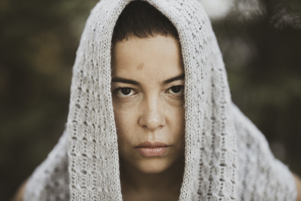 woman in white knit scarf