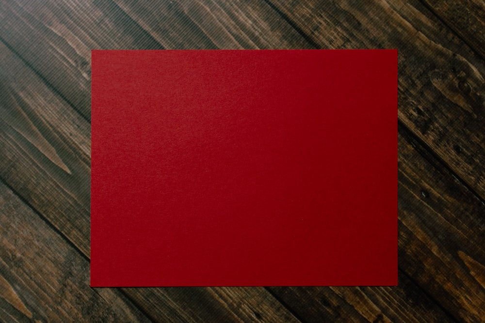 red paper on brown and gray plaid textile