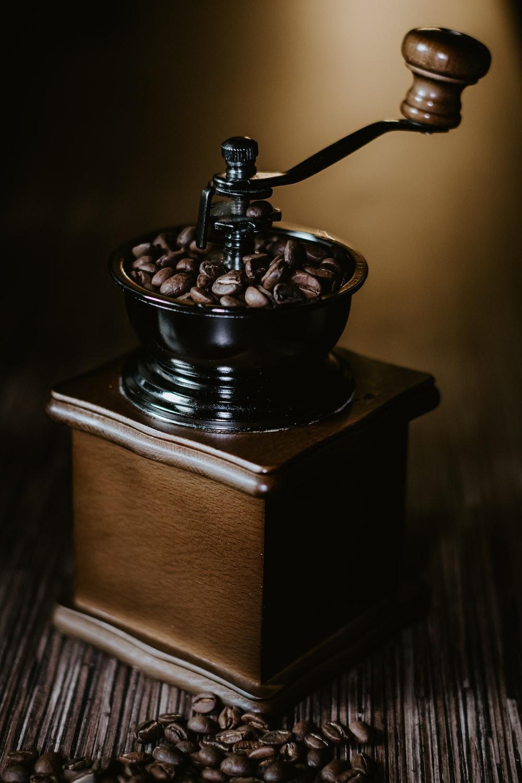 black ceramic bowl on brown wooden box