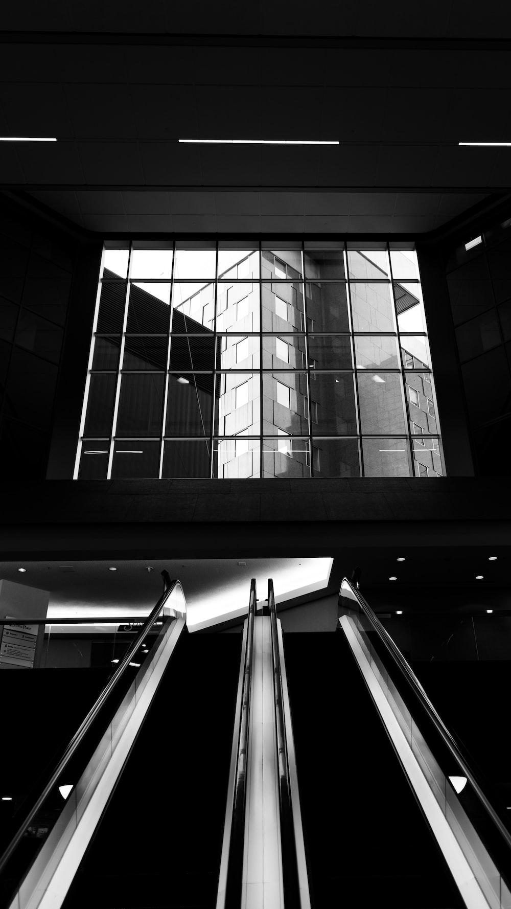 grayscale photo of a glass window