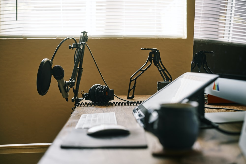 black headphones on white table