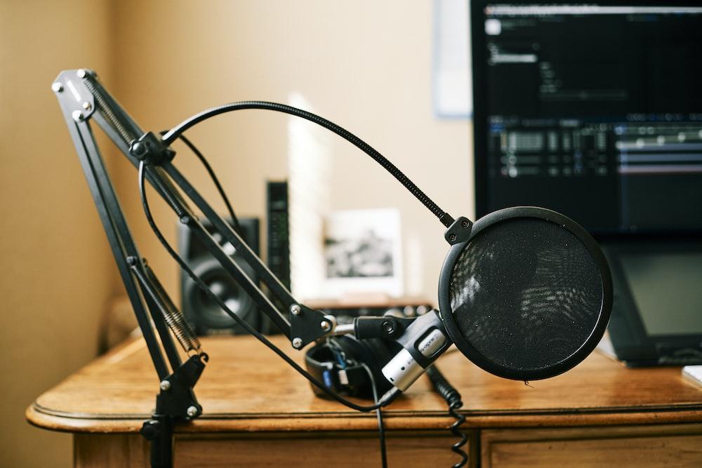 black headphones on brown wooden table