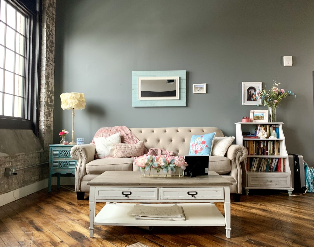 white wooden 2 layer drawer beside white couch