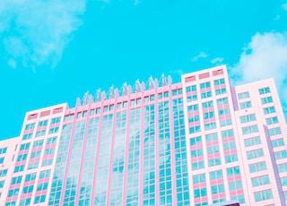 white and blue concrete building under blue sky