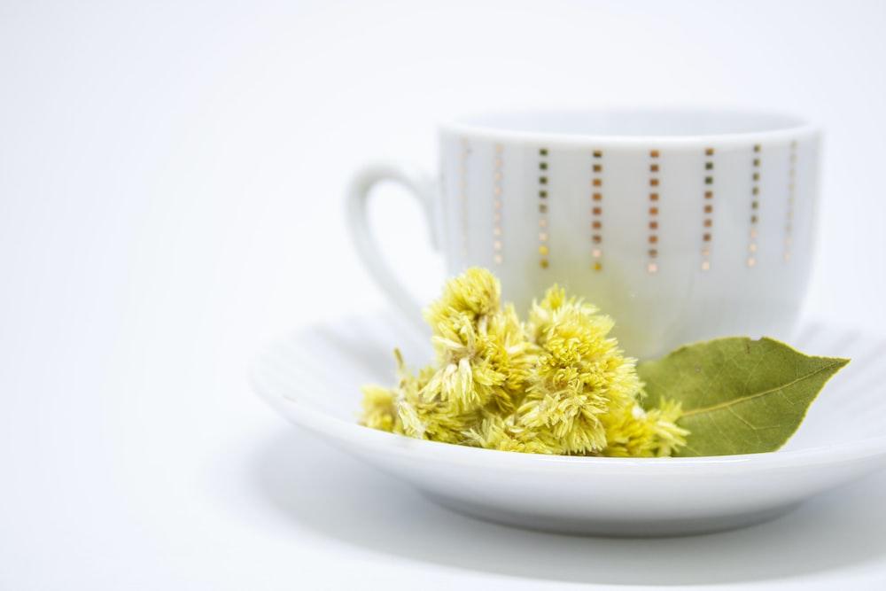 white ceramic mug with yellow powder