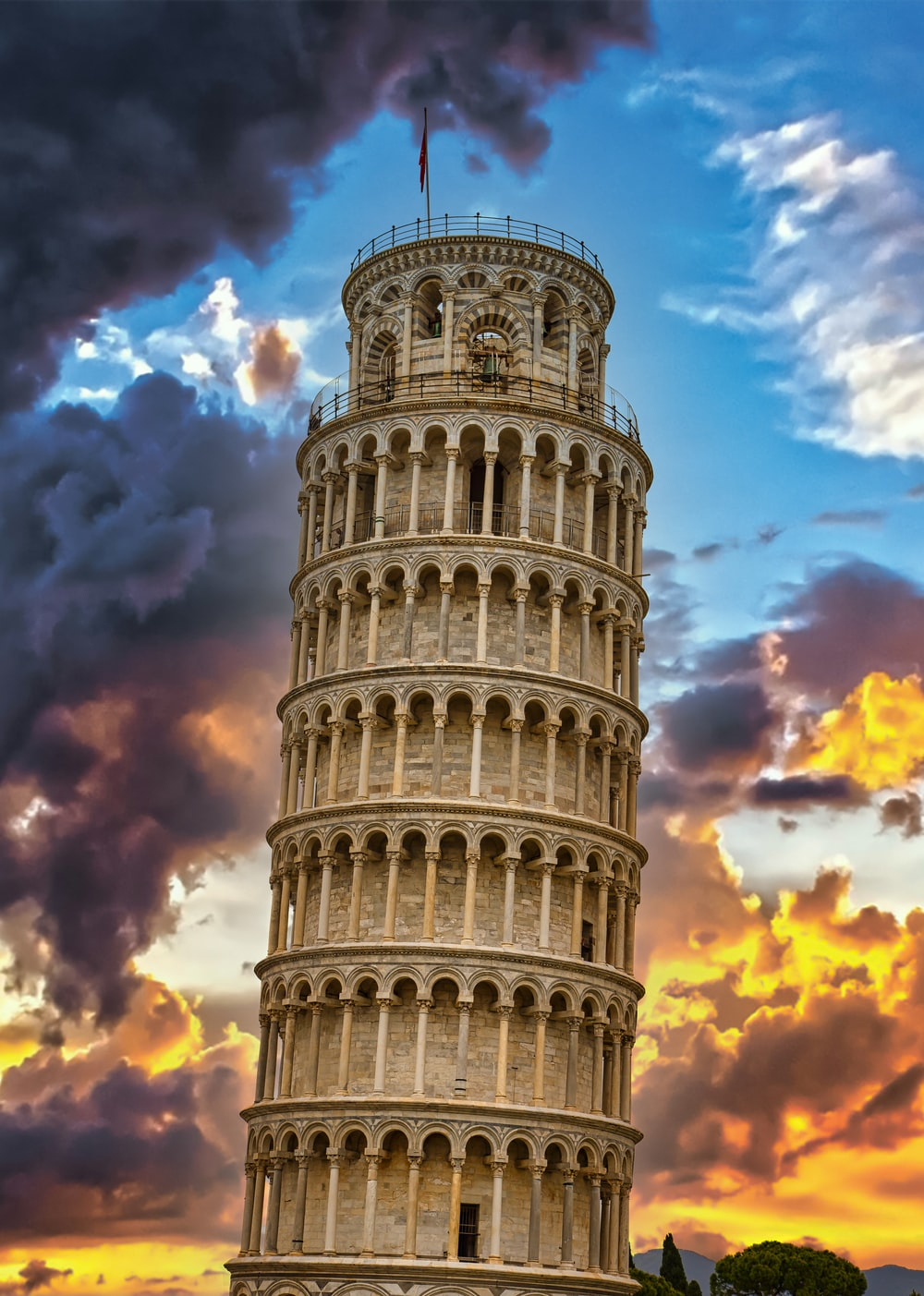 leaning tower of pisa under blue and white cloudy sky during daytime