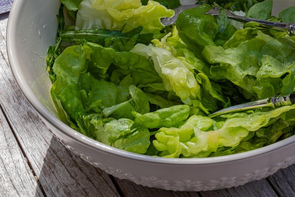 green vegetable in white plastic bowl