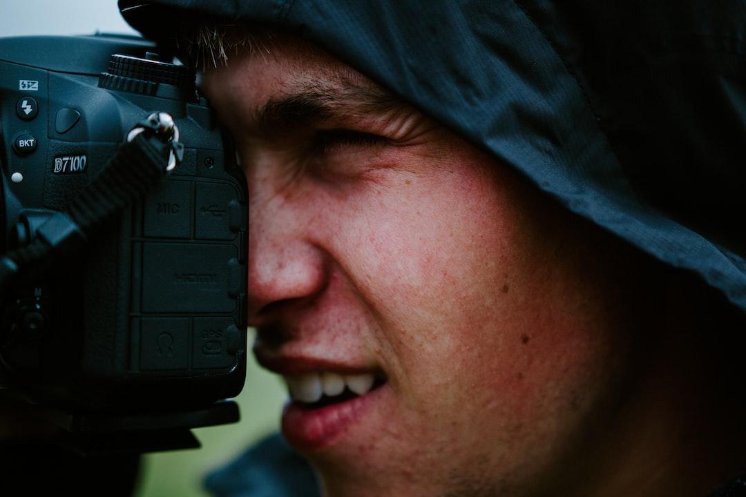 boy taking photo in the rain