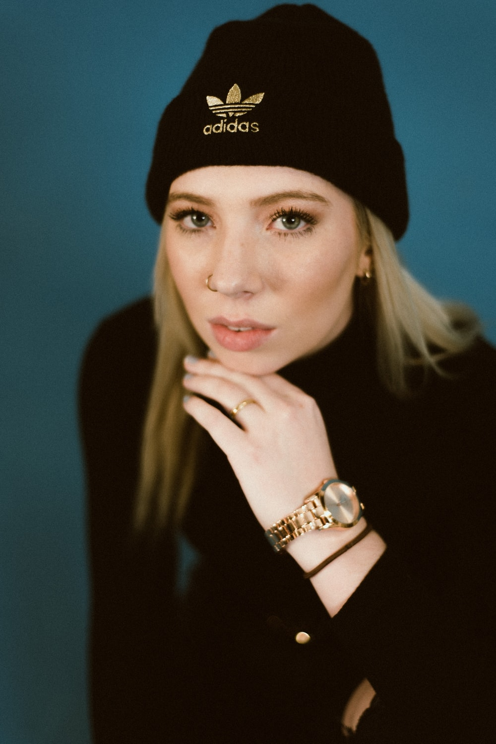 woman in black knit cap and gold ring