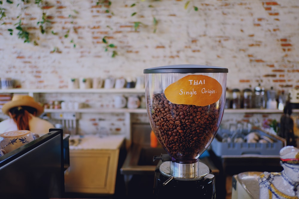 coffee beans in clear glass cup