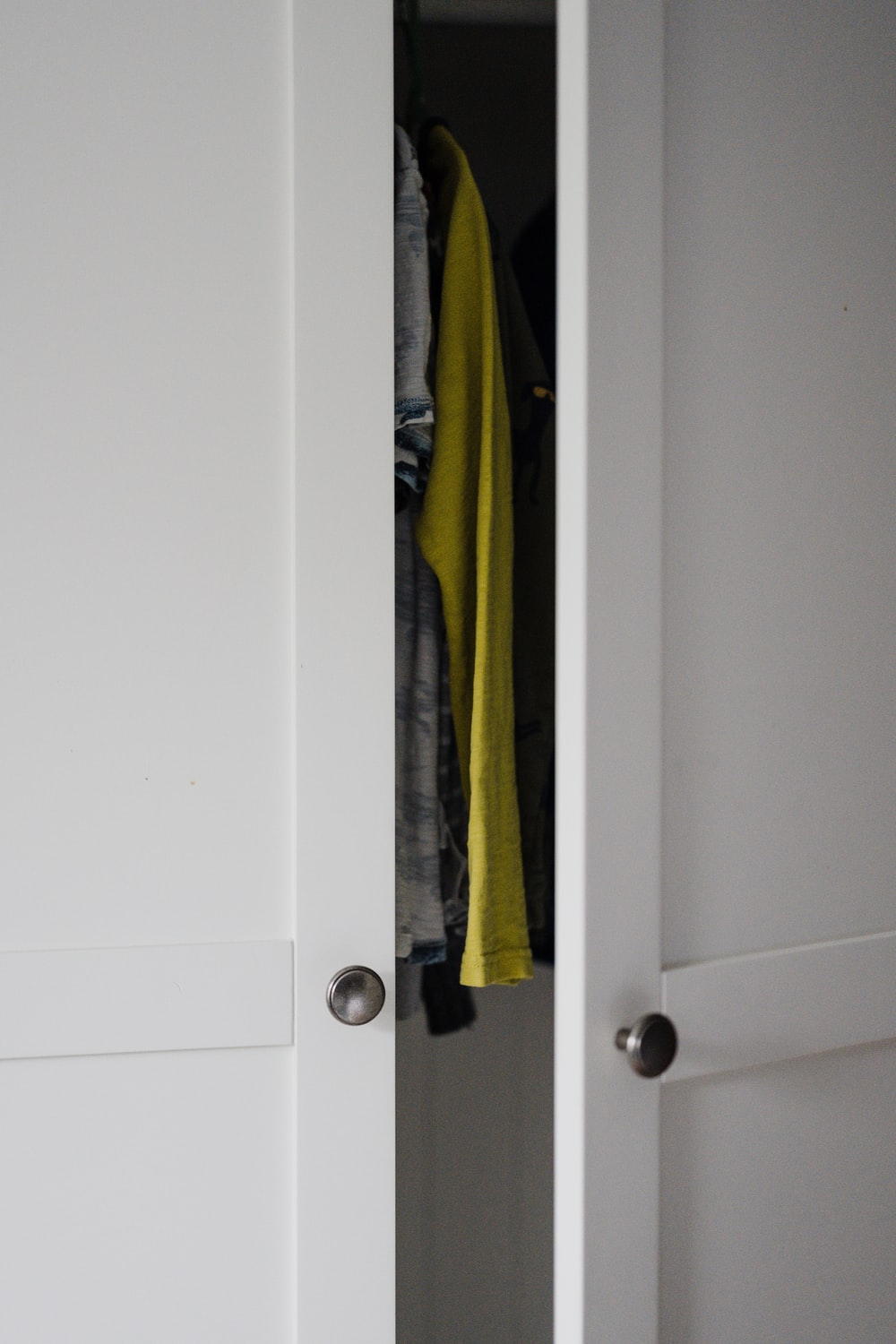 white wooden door with green and yellow textile