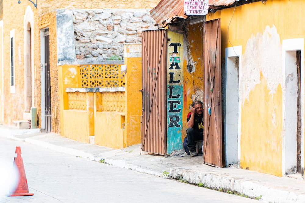 brown wooden door with graffiti