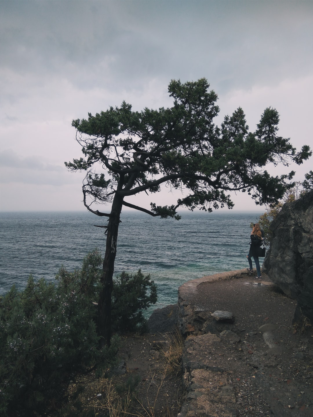 Travel girl looking at stormy Black sea