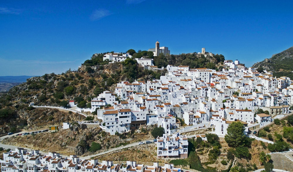 white concrete buildings on hill during daytime