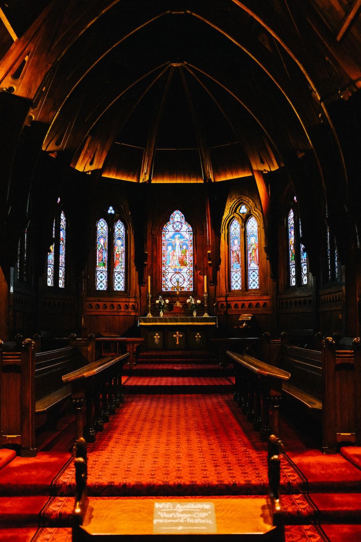brown wooden bench inside church