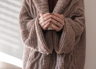 person in brown knit sweater