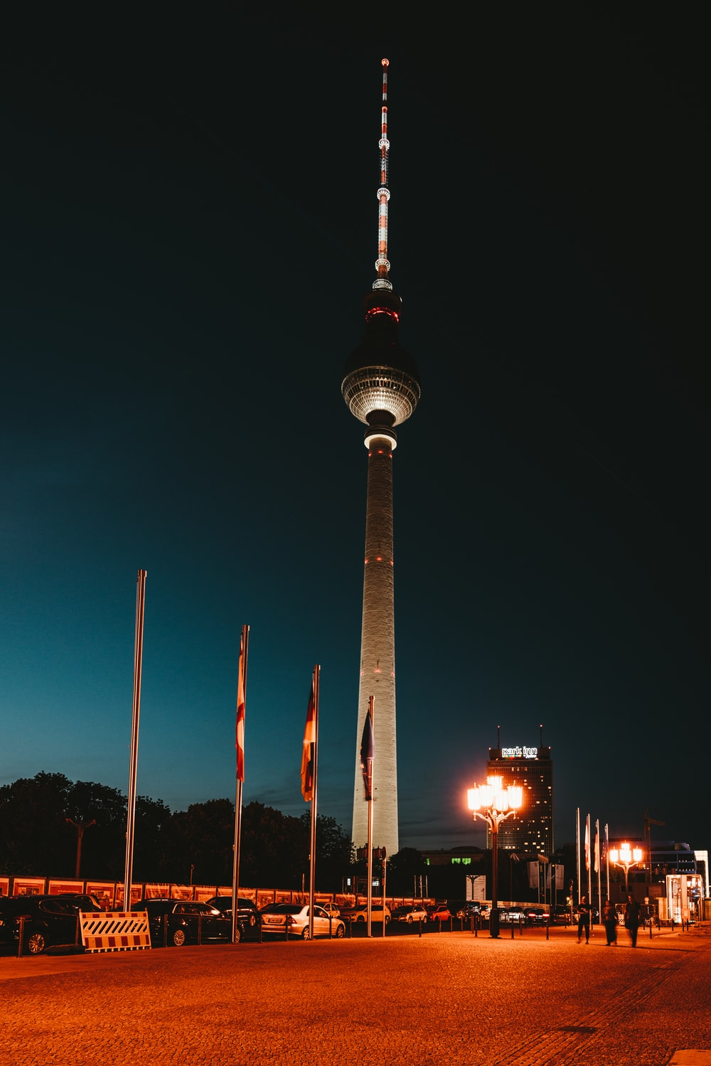 white and red tower during night time