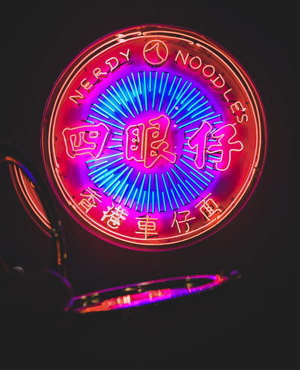 red and blue round neon light