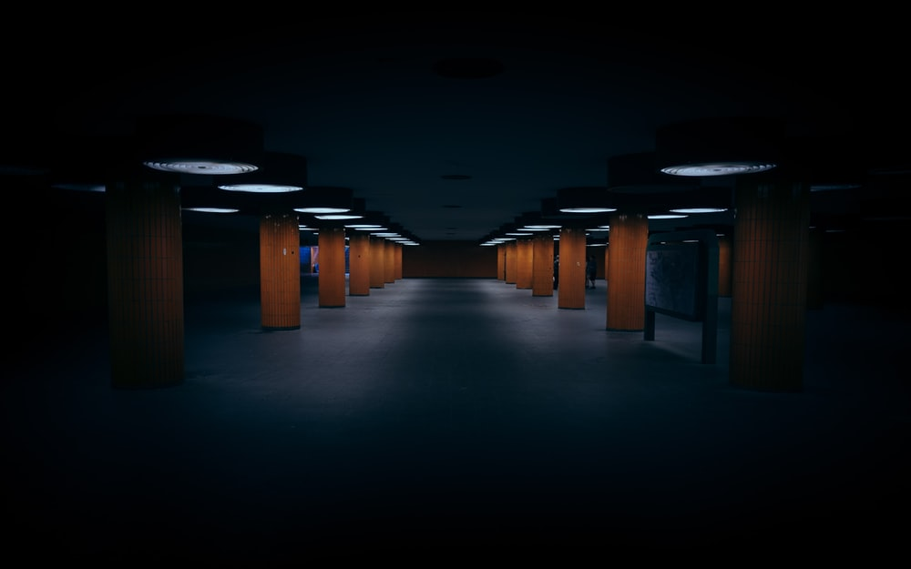brown wooden benches in a dark room