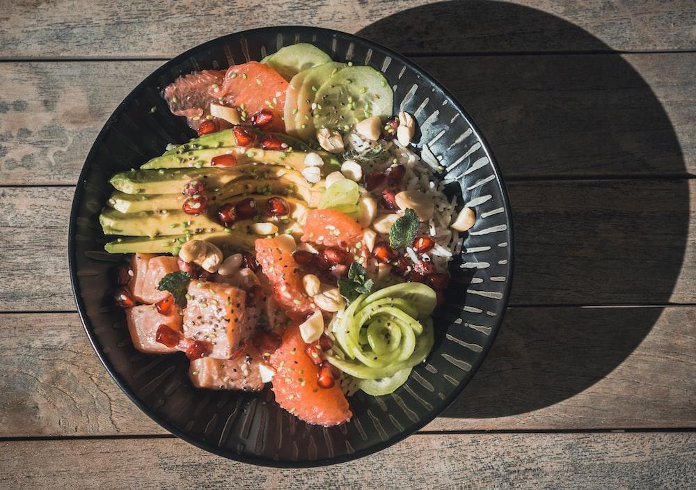 vegetable salad on black round plate