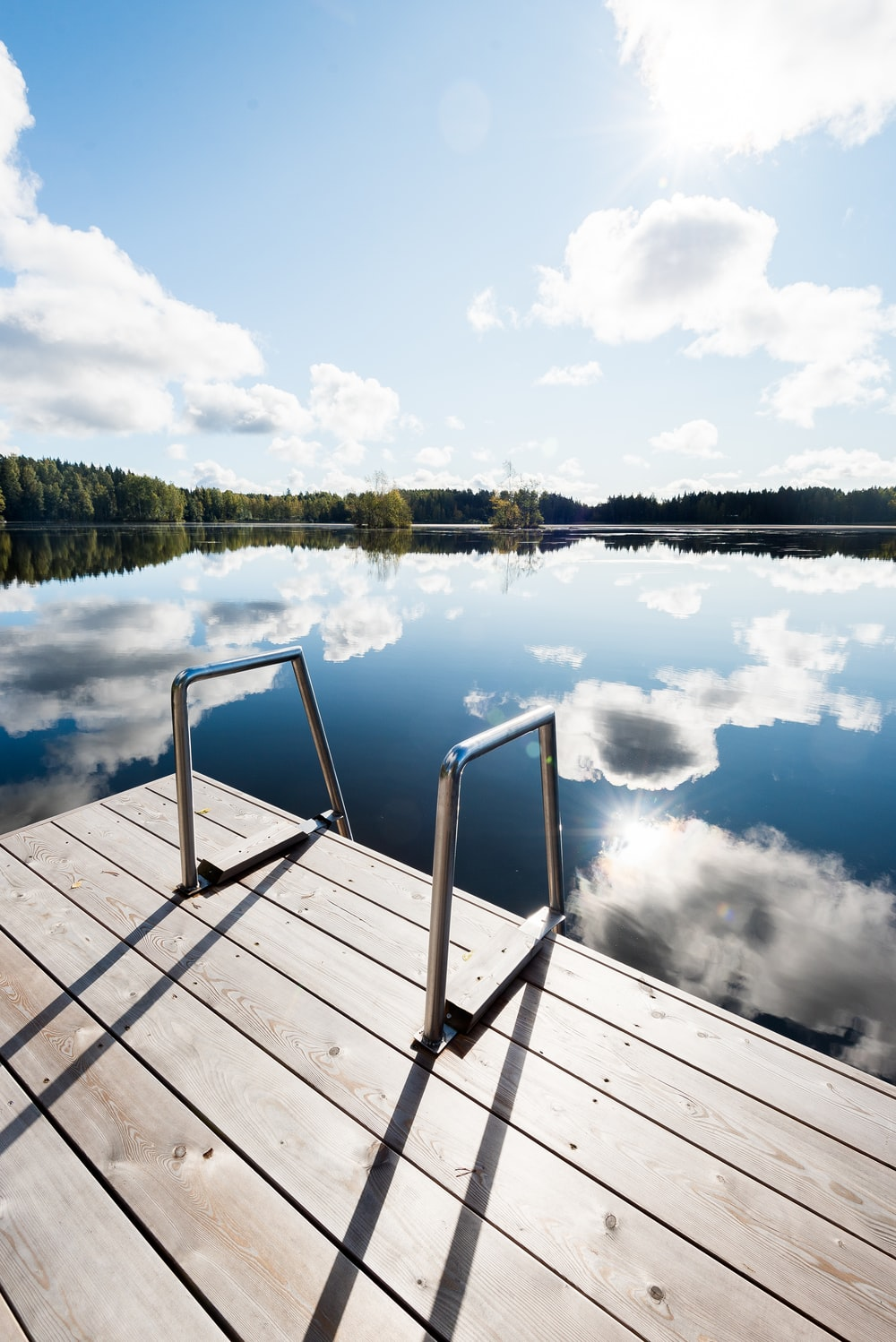 brown wooden dock over body of water during daytime