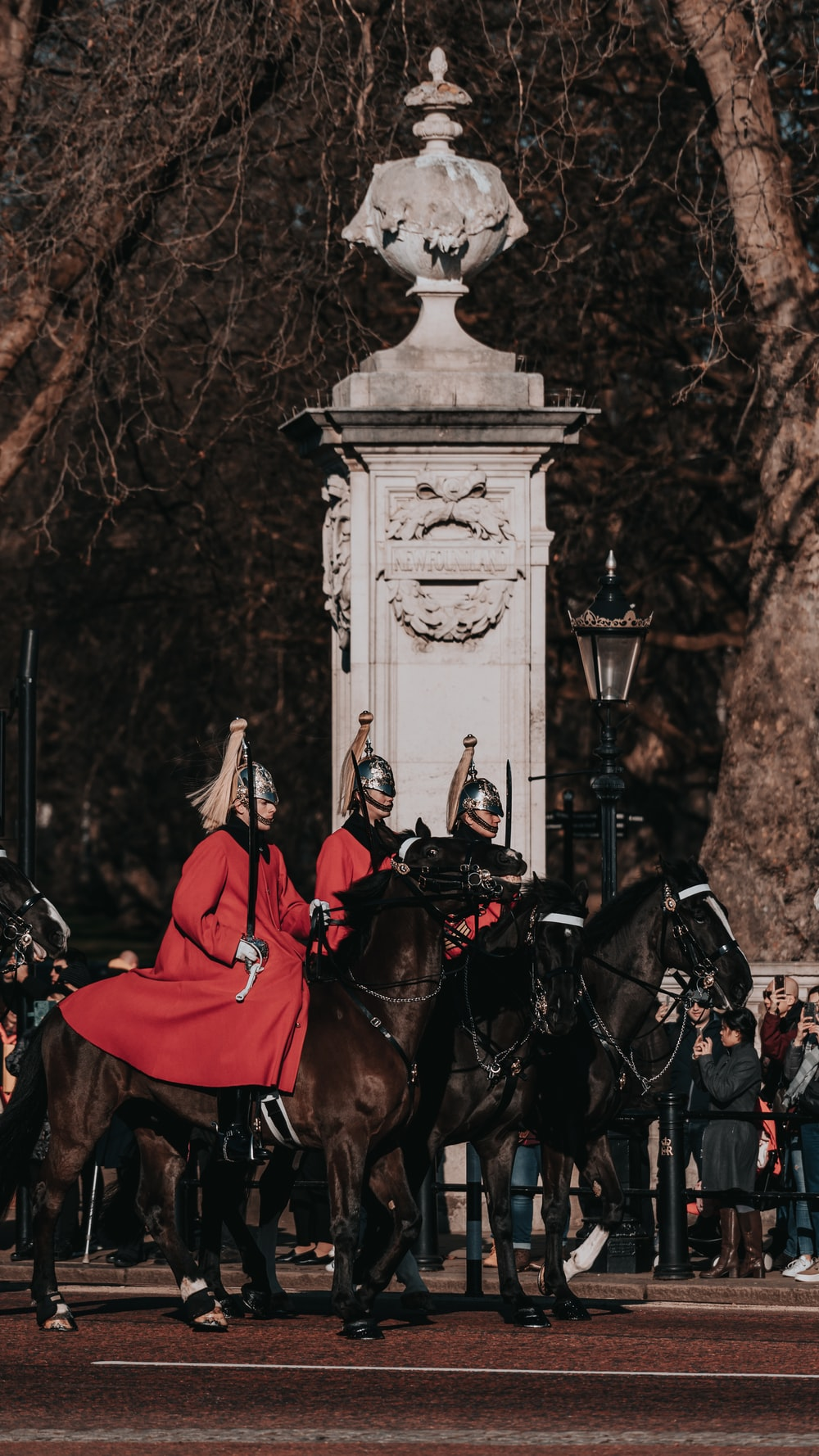 person in red coat riding horse