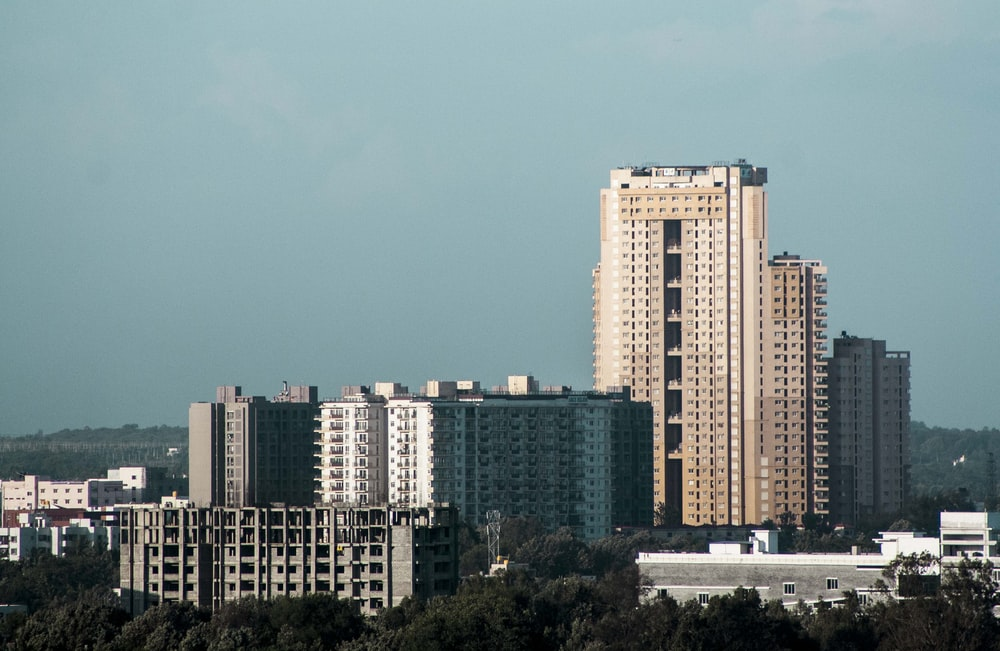 white and brown high rise building