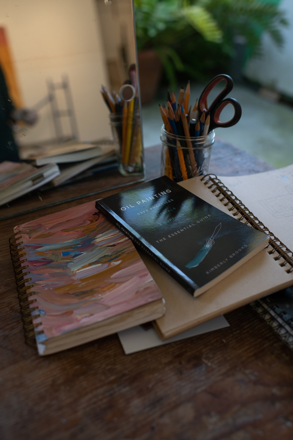 black book on brown wooden table