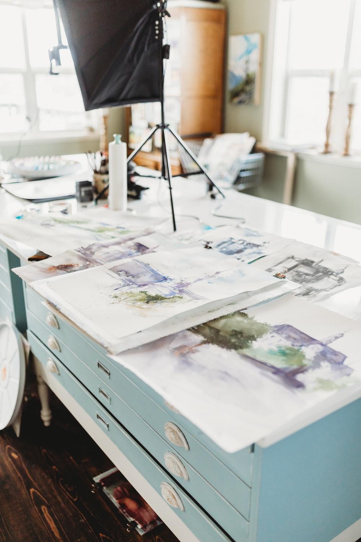 white printer papers on white wooden desk