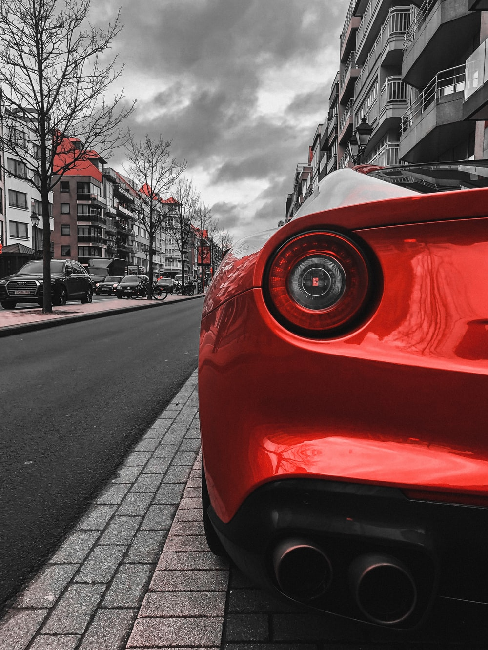 red car on the road during daytime