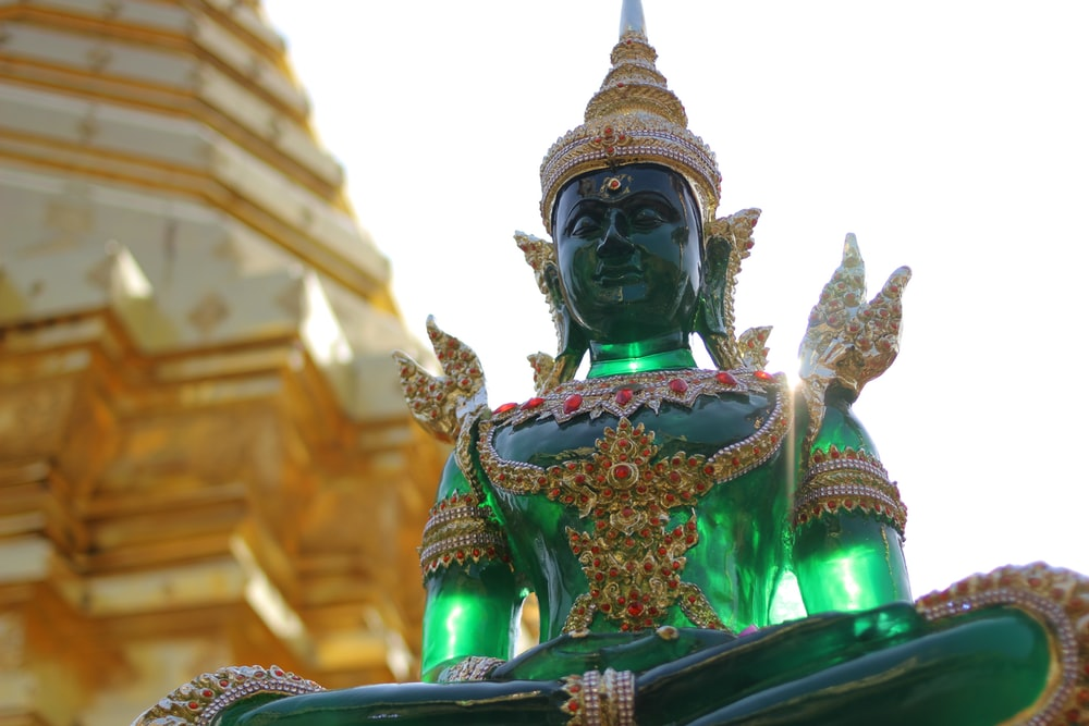 gold and green hindu deity statue