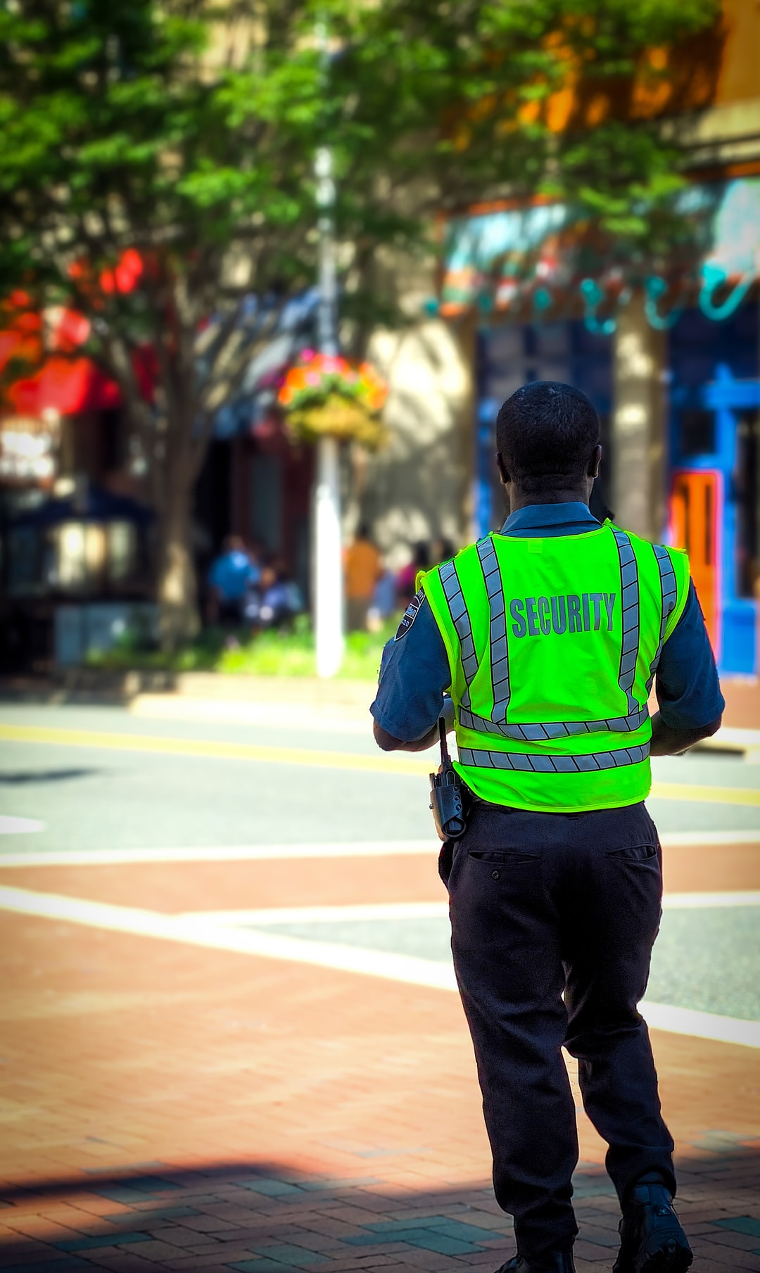 "Security Guard in a neon green vest watches over a 4way intersection in Shirlington VA. ""I miss counted the men Liz!"""