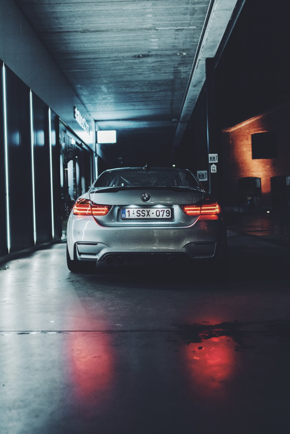 silver bmw m 3 parked in front of building
