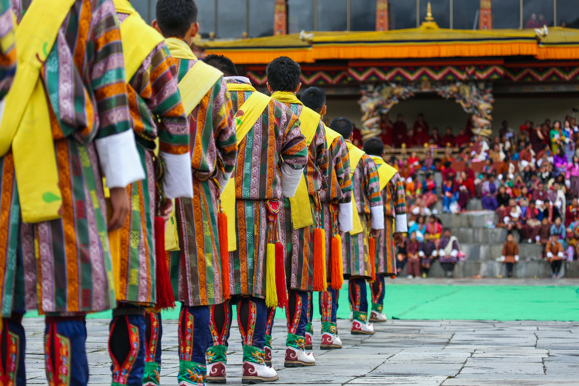 A group of male dancers get ready for a traditional item during Thimphu Tshechu (festival).