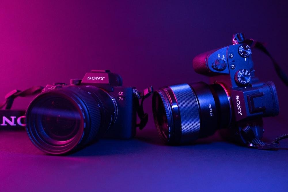 black nikon dslr camera on blue surface